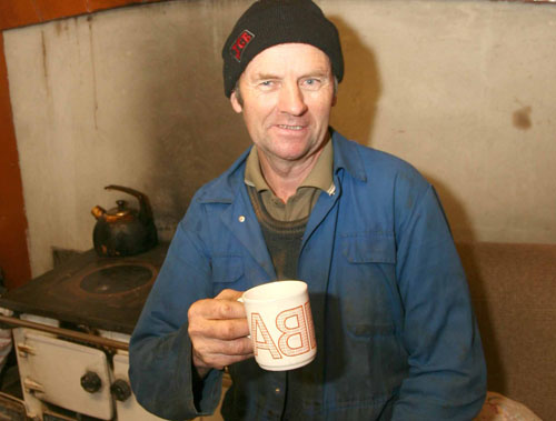 East Galway farmer Mickey Morgan enjoying a hot cup of tea at his flood stranded home. Picture: Hany Marzouk