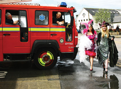 Things are hotting up nicely at GTI Fashion. In flamboyant outfits from The Studio costume hire, Spiddal, Emma Nestor and Bridget Madden attract the attention of firemen before a photocall for GTI Fashion Fiesta — a fusion of fashion and fun throughout Galway from Mon May 10 to Fri May 14 inclusive. All events throughout the week are free and everyone is welcome to go along.  All proceeds will go to Cancer Care West.   For full programme details see www.gti.ie.   Photo:-Mike Shaughnessy