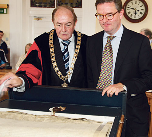 Mayor Martin Brett shows the City Charter to the visiting British ambassador Julian King, at City Hall last Tuesday. Photo: Pat Moore.