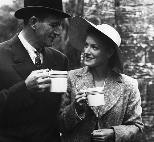 Tea break - John Wayne (Sean Thornton), and Maureen O'Hara (Mary Kate Danaher) share a joke off set  in Cong 1952 ( from Des Mac Hale's  Picture The Quiet Man by Appletree Press, 2004)