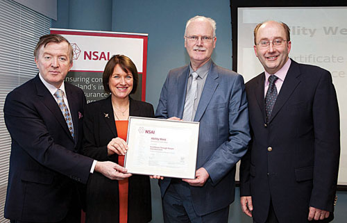 Pictured at the recent NSAI certificate presentation event are; (Left to Right) Minister for Small Business John Perry, Breda Crehan-Roche and Adrian Harney of Ability West, with NSAI chief executive Maurice Buckley.