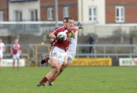 Michael Curley bursts past Conor Rafferty during last Sunday's win over Louth. Photo: johnobrienimages.com