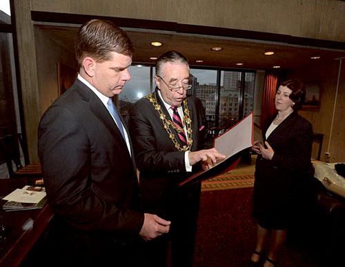 Mayor Conneely presents a formal letter of congratulations to Mayor Marty Walsh following his inauguration as Mayor of Boston.  Also in the photo is Edel McCormack, head of finance- Galway City Council.