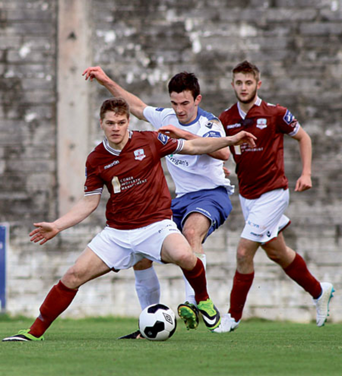 Galway FC's Colin Horgan comes under pressure from Josh Mailey of Finn Harps in action from the EA Sports Cup game at Eamonn Deacy Park on Monday.  Photo:-Mike Shaughnessy