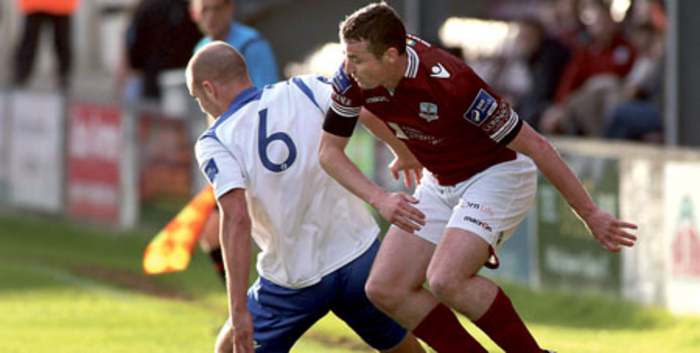 Jake Keegan, Galway FC, and Ciaran Coll of Finn Harps in action at Eamonn Deacy Park. 	  Photograph:  Mike Shaughnessy