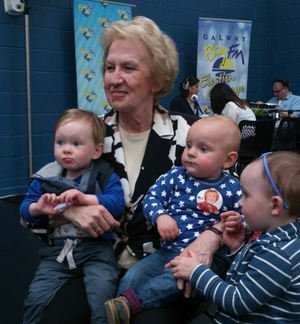 Terry O'Flaherty pictured with her two grand-nephews and her grand-niece in the Westside Community Centre today (Saturday May 24).