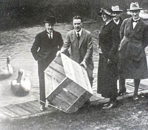 Oliver St John Gogarty releasing two swans into the river at the Trinity College Boat Club,  at the Liffey's Islandbridge, 1924. Also in the picture is WT Cosgrave (front left), and in the back, WB Yeats.