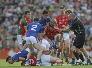 Man and ball: Aidan O'Shea tries to free himself from a pile of bodies on the ground. Photo: Sportsfile