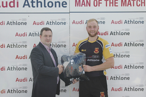 Richie Hickey presents the Audi Athlone Man of the Match award to Josh O'Rourke after Buccaneers' win over Garryowen.