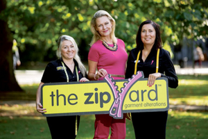 Laura Bermingham launches the'Sew Pink' campaign with The Zip Yard staff